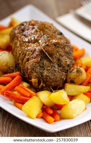 Roast Beef with Potatoes and Carrots - stock photo