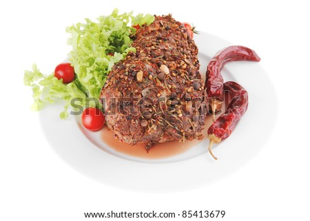 roast beef with vegetables on white plate