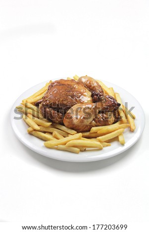 roast chicken and french fries - stock photo