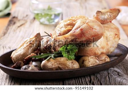 Roast chicken and potatoes  - stock photo
