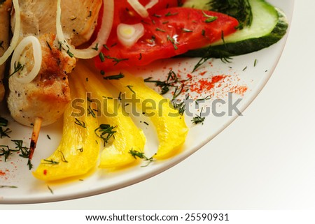 Roast chicken and yellow paprika on plate