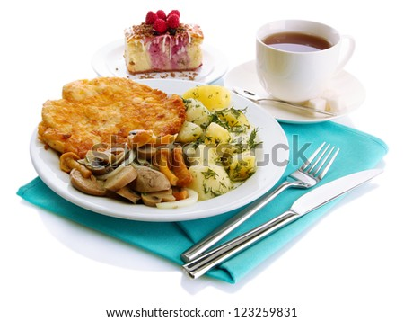 Roast chicken cutlet with boiled potatoes and  vegetables, cup of tea and dessert, isolated on white