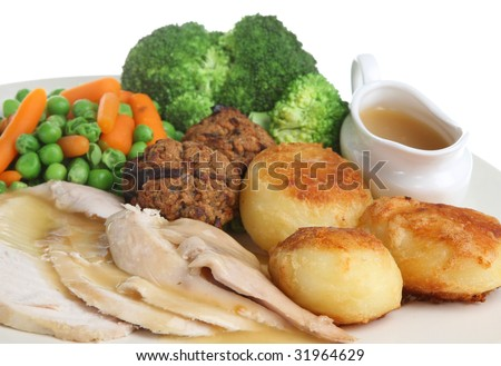 Roast chicken dinner with stuffing and individual gravy boat - stock photo