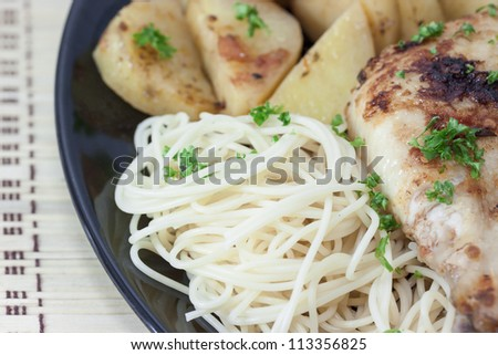 Roast chicken leg with angel hair pasta and tomato. - stock photo