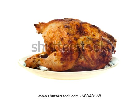 Roast chicken on a plate isolated on the white - stock photo