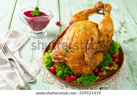 Roast chicken with cranberry sauce for a festive dish - stock photo
