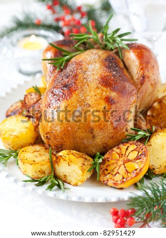 Roast chicken with potatoes,lemons and rosemary for Christmas