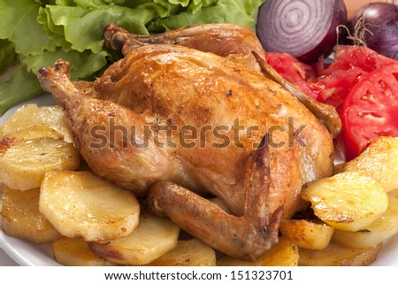 roast chicken with potatoes, vegetables and salad