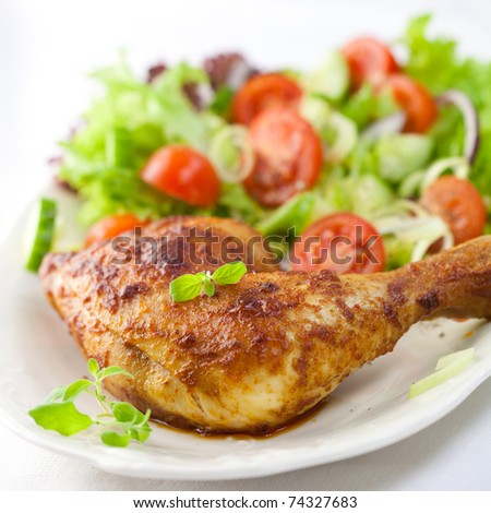 Roast chicken with salad and fresh herbs - stock photo