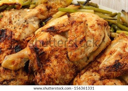Roast chicken with vegetables - stock photo