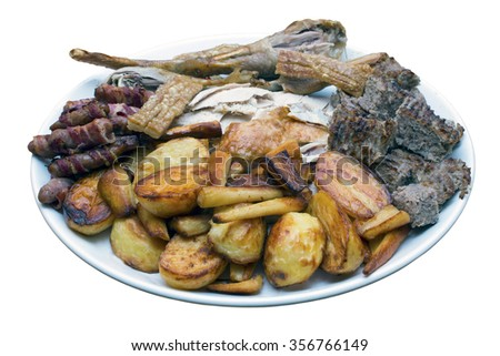 Roast dinner serving platter with turkey, roast potatoes, parsnips, sausages, stuffing and crackling on an isolated white background with a clipping path - stock photo