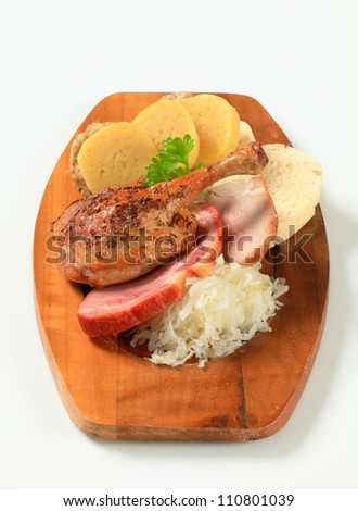 Roast duck and pork meat with three kinds of dumpling and white cabbage  - stock photo