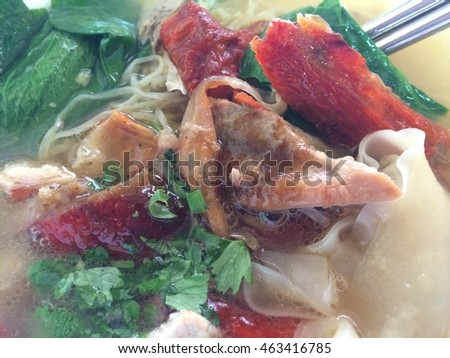 Roast duck noodle in white bowl eat with noodle soup in breakfast or lunch and dinner
