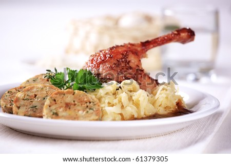 Roast duck, sauerkraut and dumplings - stock photo
