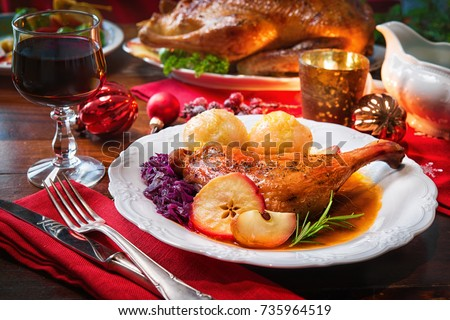 Roast duck with dumplings, red cabbage and apples