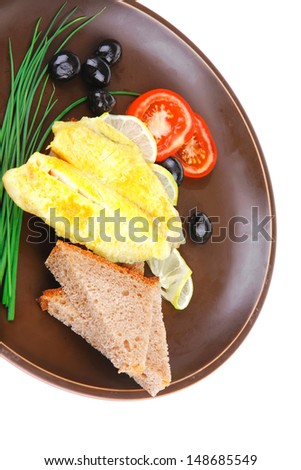 roast fish fillet with tomatoes,chives and bread on plate
