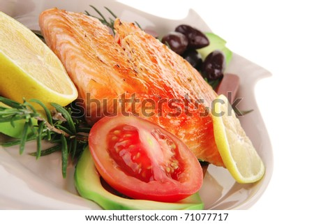 roast fish: hot grilled salmon on glass plate isolated on white background - stock photo