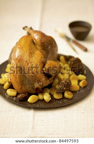 Roast guinea-fowl capon with morels and pan-fried gnocchis