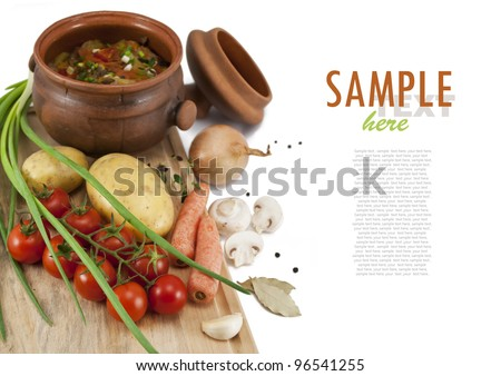 Roast in a pot and ingredients: potatoes, carrots, tomatoes, onions, mushrooms, garlic, black pepper and bay leaf. With sample text . Isolated on white . - stock photo