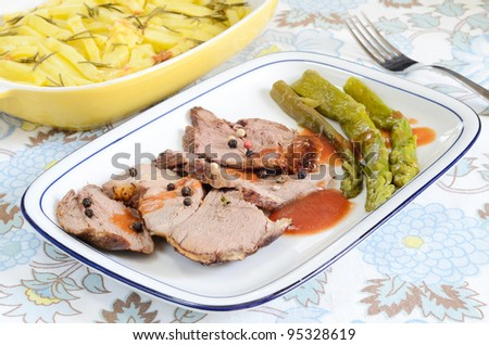 Roast lamb and asparagus in barbecue sauce - italian cuisine