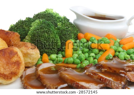 Roast lamb dinner with individual gravy boat