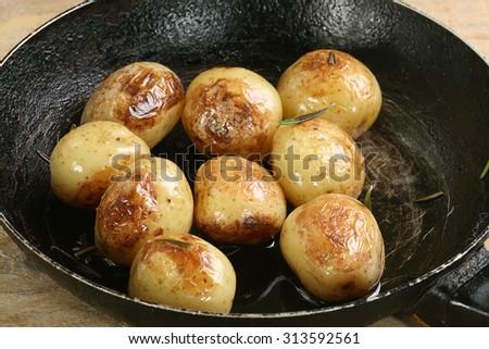 roast new potatoes with garlic and rosemary - stock photo