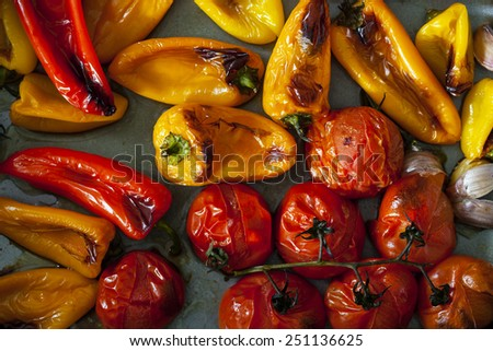 Roast peppers and tomatoes on baking tray - stock photo