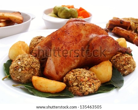 roast pheasant with vegetables - stock photo