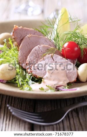 Roast pork tenderloin served with vegetables - stock photo