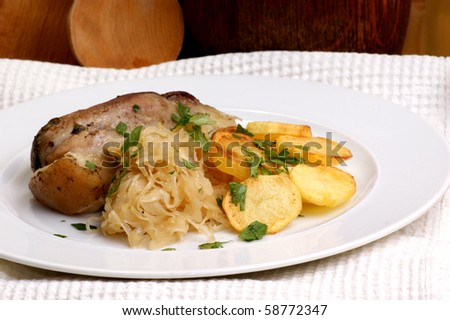 roast pork with organic sauerkraut and potato