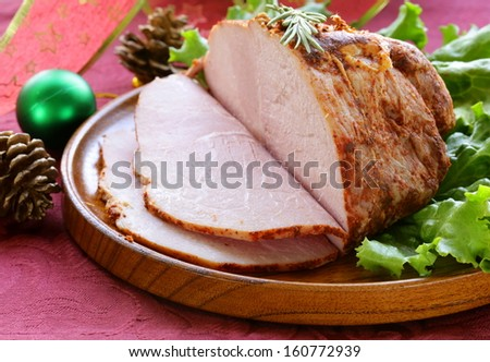roast pork with paprika and rosemary for Christmas dinner - stock photo