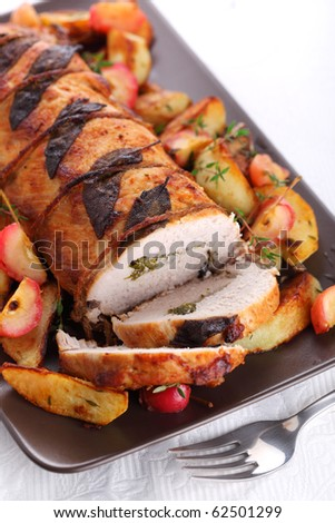 Roast pork with sage and thyme sauteed potatoes and spiced apple sauce - stock photo