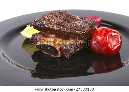 roast rib's on black dish close up - stock photo