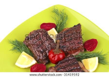 roast rib's on green dish close up - stock photo