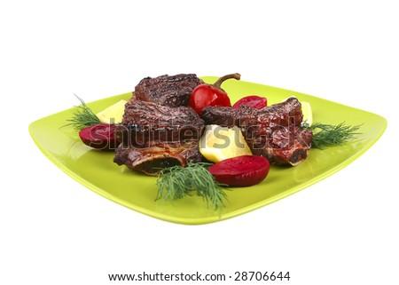 roast rib's on green dish side view - stock photo