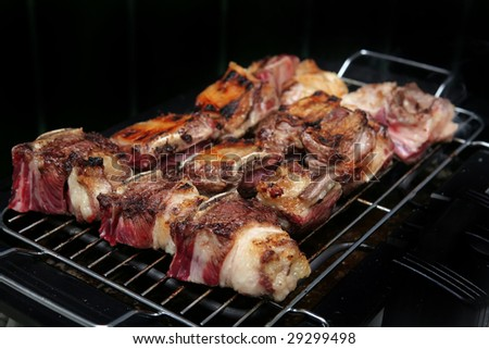 roast ribs on electrical roaster ready to eat - stock photo