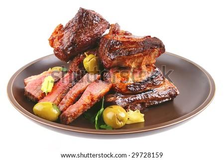 roast ribs on old style ceramic dish - stock photo