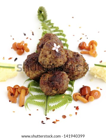 Roast rissoles served with mashed potatoes and marinated mushrooms - stock photo