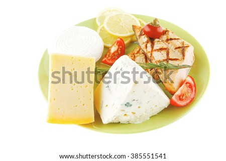 roast salmon and soft cheeses on green over white - stock photo