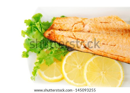 roast salmon fillet with butter on white plate