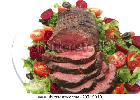 roast sliced red meat and vegetables - stock photo