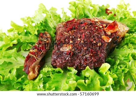 roast steak served on green salad on bowl - stock photo