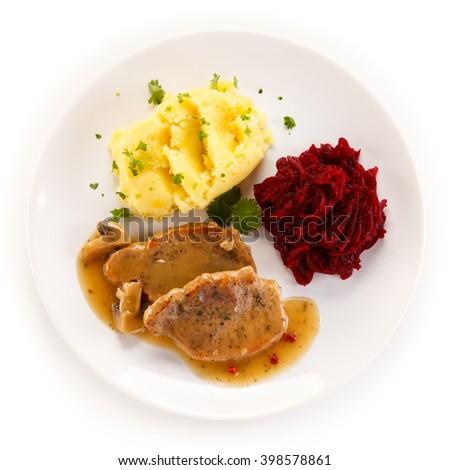 Roast steaks, boiled potatoes and vegetable salad  - stock photo
