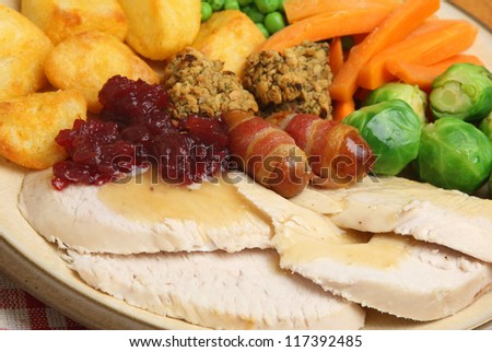 Roast turkey Christmas dinner with traditional trimmings. Shallow Dof, focus on centre of image. - stock photo