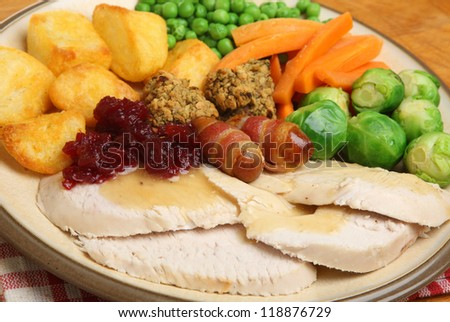 Roast turkey Xmas dinner with traditional trimmings. - stock photo