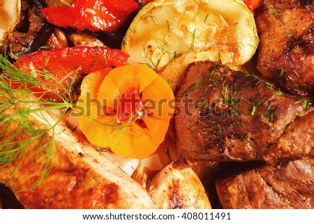 roast with baked vegetables - zucchini, pepper and dill - stock photo