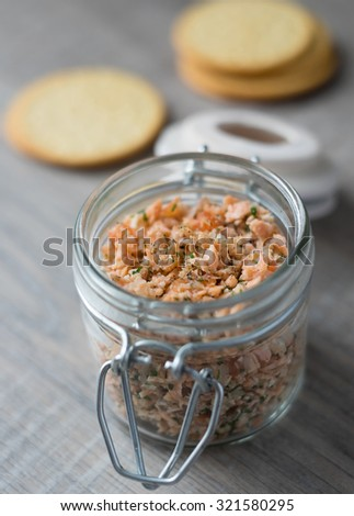 Roasted and smoked salmon fish, soft cheese and egg pate in glass jar, selective focus - stock photo