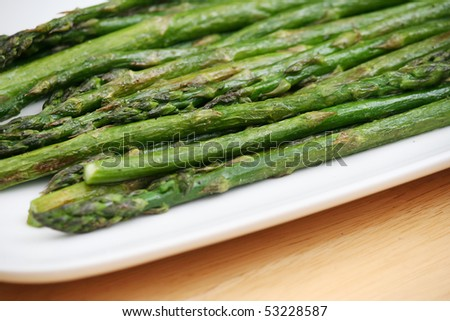 Roasted Asparagus on a White Plate - stock photo