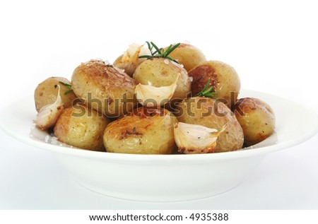 Roasted baby potatoes, with garlic, rosemary and salt. - stock photo