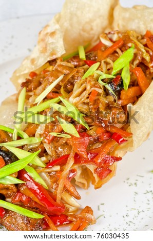 Roasted Beef at sour-sweet sauce on a plate - stock photo